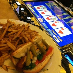 Photo taken at Race & Sports Book by Wing King on 9/2/2013