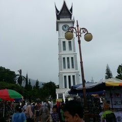 Photo taken at Jam Gadang by Revi W. on 12/31/2012