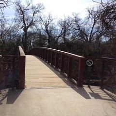 Photo taken at Barton Springs Pedestrian Bridge by Dominic M. on 2/15/2013