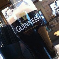 Photo taken at Tigín Irish Pub & Restaurant by Daniel C. on 1/16/2013