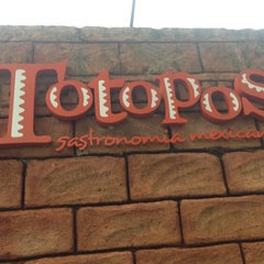Photo taken at Totopos Gastronomia Mexicana by 41 Delivery C. on 3/12/2013