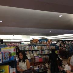 Photo taken at Books Kinokuniya 紀伊國屋書店 by Tina M. on 12/1/2012