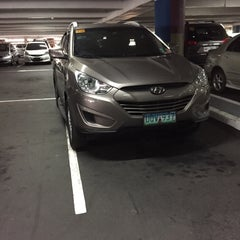 Photo taken at Greenbelt 1 Parking by Adrian A. on 3/28/2015