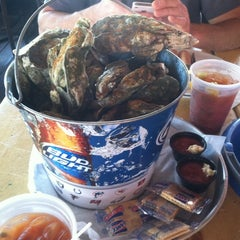 Photo taken at The Folly Beach Crab Shack by Ashley C. on 10/28/2012
