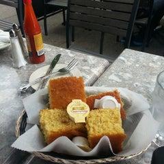Photo taken at Sylvia's Restaurant by Lorenzo C. on 5/18/2013