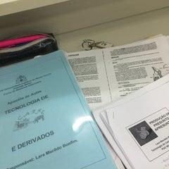 Photo taken at Biblioteca PUC Minas by Fernanda A. on 6/9/2015