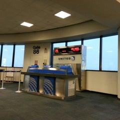 Photo taken at Gate C86 by Matthew P. on 10/24/2012