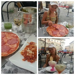 Photo taken at Piazza Dante by Olga A. on 6/12/2014
