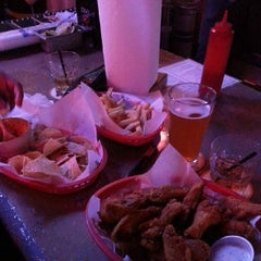 Photo taken at Junction Bar & Grill by Bink on 2/23/2014