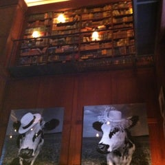 Photo taken at The Library at Hudson Hotel by Valdete S. on 12/25/2012