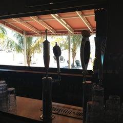 Photo taken at Laguna Grill & Martini Bar by Kathleen M. on 6/15/2013