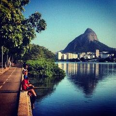 Photo taken at Lagoa Rodrigo de Freitas by Lucas M. on 6/1/2013