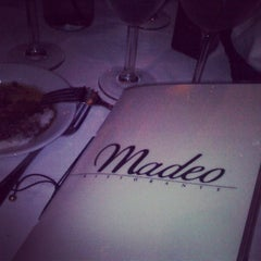 Photo taken at Madeo Restaurant by TripOrTreats.com on 4/11/2013