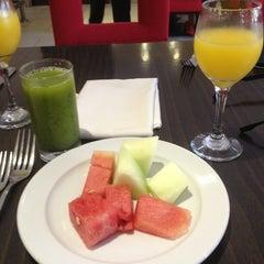 Photo taken at El Palmar Restaurant by Lluvia R. on 7/20/2013