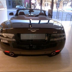 Photo taken at Aston Martin by Tara P. on 4/6/2013