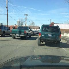 Photo taken at Michigan Street Railroad Crossing by Brandon R. on 3/8/2013
