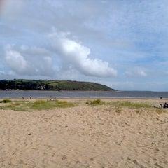 Photo taken at Llansteffan Beach by Courtenay P. on 8/3/2013