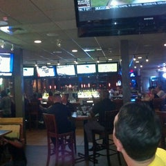 Photo taken at Smokey Bones Bar & Fire Grill by Fernando U. on 5/24/2013