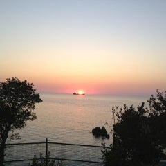 Photo taken at Kapuz Plajı by 🚙esra✈ on 7/25/2013