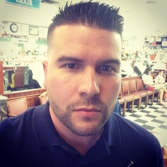 Photo taken at Carl's Barber Shop by Carlos G. on 2/15/2014