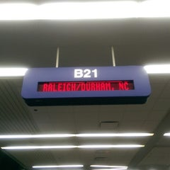 Photo taken at Gate B21 by Mike C. on 4/21/2014