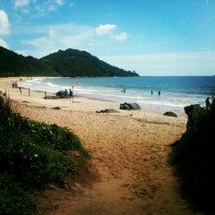 Photo taken at Praia Brava by Renato B. on 3/12/2013