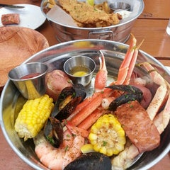 Photo taken at Coast Seafood & Raw Bar by Daphne L. on 6/8/2013