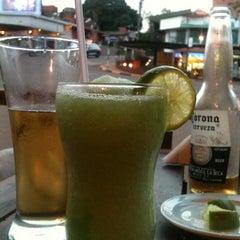 Photo taken at Bambu Resto Bar by Vane K. on 10/7/2012