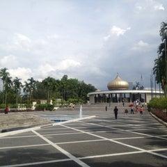 Photo taken at National Monument (Tugu Negara) by Weng L. on 4/6/2013