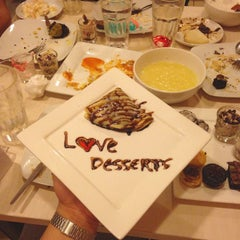 Photo taken at Love Desserts by Ashley A. on 3/9/2015