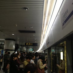 Photo taken at 上海体育馆地铁站 | Shanghai Indoor Stadium Metro Stn. by motoki k. on 4/10/2013