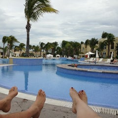 Photo taken at Poolside by Signe B. on 12/16/2012