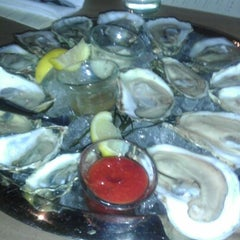 Photo taken at Henlopen City Oyster House by s4mie_sosa on 12/24/2012