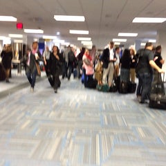 Photo taken at Concourse C by Eric A. on 10/20/2014