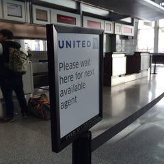 Photo taken at United International Check In by Eric A. on 2/18/2014