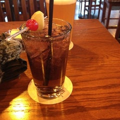 Photo taken at Tilted Kilt Pub & Eatery by Zoe L. on 12/26/2012