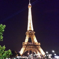 Photo taken at Tour Eiffel by Teik Chuan L. on 7/26/2013