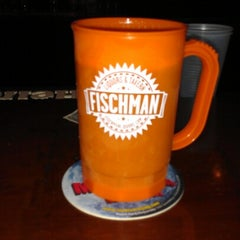 Photo taken at Fischman Liquors & Tavern by Keith B. on 10/13/2012