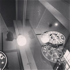 Photo taken at Starbucks by Erika F. on 4/11/2013