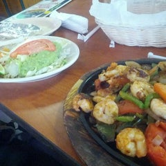 Photo taken at El Nopalito Mexican Restaurant by Andre R. on 6/19/2014