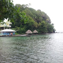 Photo taken at Isla Grande Colon by Fabi M. on 10/14/2012