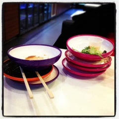 Photo taken at YO! Sushi by Ayse on 3/21/2013