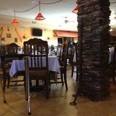 Photo taken at La Siesta Restaurant Bar by Alejandro A. on 2/18/2013