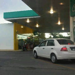 Photo taken at Petronas by sharifah norfadhilatul a. on 12/21/2011