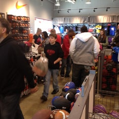 Photo taken at Nike Factory Store by Ty B. on 2/18/2012