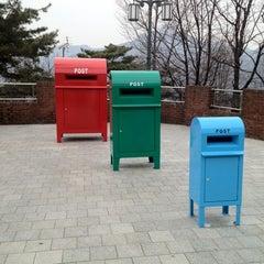 Photo taken at 북악스카이웨이 팔각정 (Bukak Skyway Palgakjeong) by Buffett K. on 3/29/2012