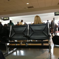 Photo taken at Gate C28 by Sam O. on 6/5/2013