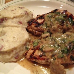 Photo taken at Carrabba's Italian Grill by Monica B. on 12/24/2012