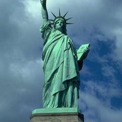 Photo taken at Statue of Liberty by Guru J. on 4/6/2013