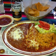 Photo taken at Los Pericos Taqueria by Phoebe on 11/20/2012